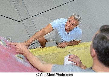 aged man climbing wall