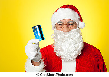 Aged man in Santa clothing ready to shop this Christmas, ...
