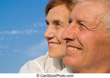 aged people at sky - portrait of a happy old couple at sky