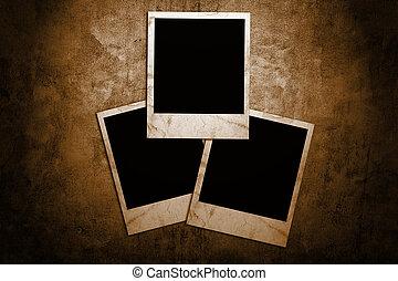 Aged photo frames on grunge background