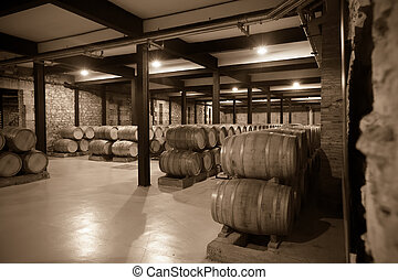 Aged photo of old  winery  with   barrels