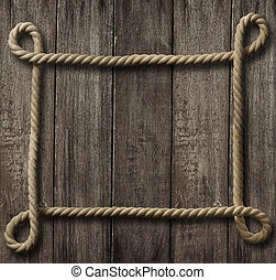 aged rope frame on old wood background