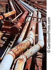 Aged rusty grunge industrial pipe lines on a mine industry