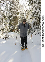 aged senior with snowshoes
