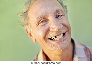 aged toothless man smiling at camera - portrait of senior...