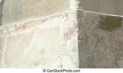 Aged wall texture. Dirty and shabby wall. Time subdues...