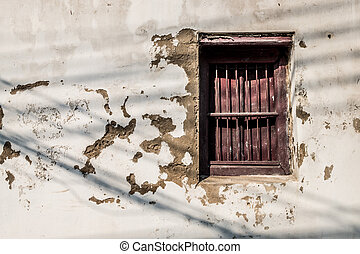 Aged wall with old red window