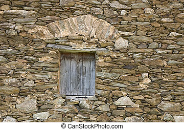 Aged window - An old window closed with a wooden shutter