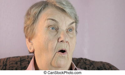 Aged woman 80s sitting indoors covers face hands - Aged...