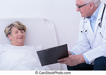 Aged woman and experienced doctor