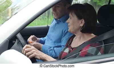 A woman takes a driving test with an instructor