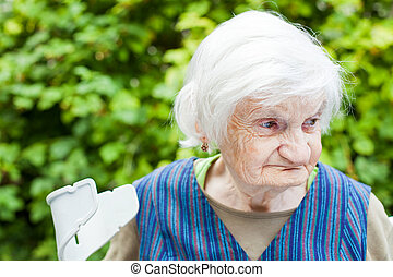 Aged woman in the garden