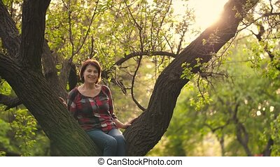 Aged woman on a tree