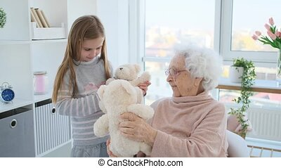 Aged woman playing with girl