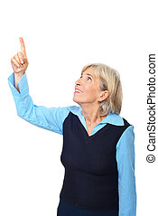 Aged woman pointing to copy space