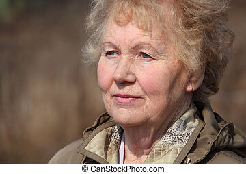 Aged woman face, spring outdoor