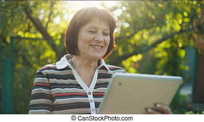 Aged Woman Talking by Skype - Cheerful Aged Woman connected...
