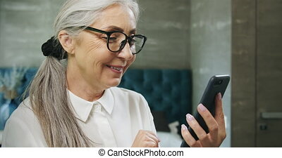 Aged Woman Texting on Smartphone
