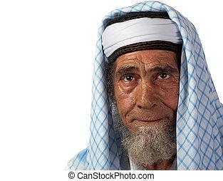Ageing senior - A senor man in traditional garment appears...