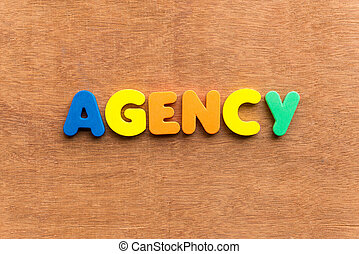 agency colorful word on the wooden background