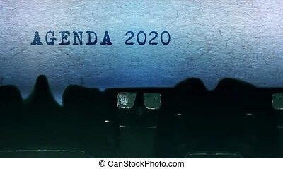 Agenda 2020 words Typing on a sheet of paper with an old vintage typewriter.