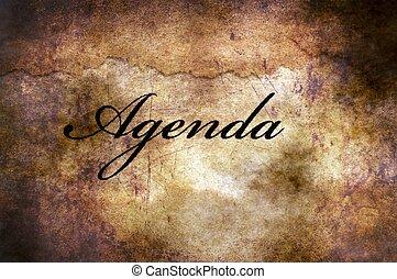 Agenda text on grunge background