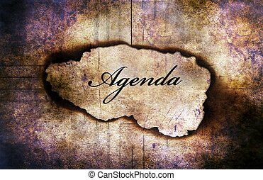 Agenda text on paper hole concept