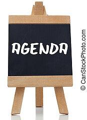 Agenda written in white on blackboard