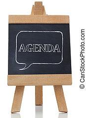 Agenda written on a blackboard against white background