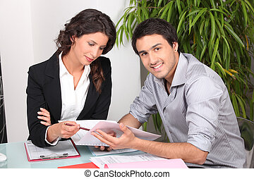 Agent and client discussing a document