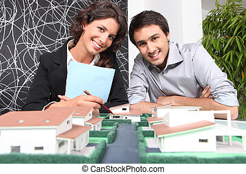 Agent and client looking at a new-build property model