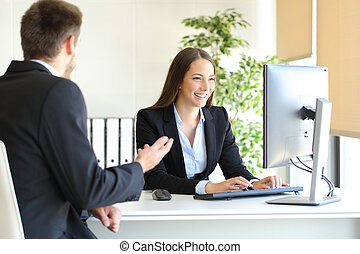 Agent attending a client at office