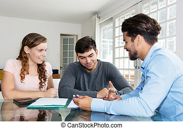 Agent explaining rental contract to couple