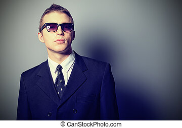 agent secret - Portrait of a handsome young man in a suit....