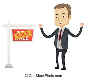 Agent standing near sold real estate sign.