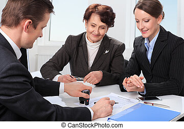 Agent with senior woman and her daughter