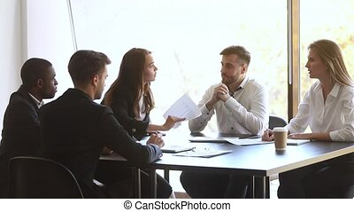 Aggressive blond and brunette businesswomen conflict during business meeting