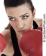 Aggressive boxing woman over white background