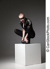 aggressive fashion girl wearing in dark rock style
