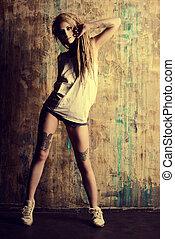 aggressive fashion - Modern girl with blonde dreadlocks....