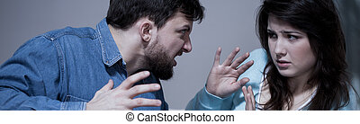 Aggressive man arguing with wife