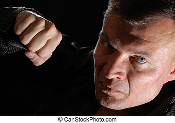 aggressive man - close-up studio portrait of a middle-aged ...