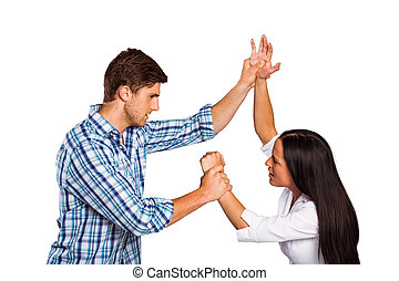 Aggressive man overpowering his girlfriend on white...