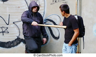 Aggressive man with a baseball bat