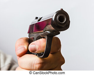 man with a black gun in his hand - Aggressive man with a ...
