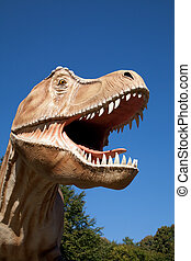 Aggressive T-Rex close-up on a blue sky