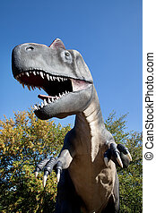 Aggressive T-Rex close-up on a blue sky