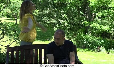 aggressive wife shout husband near park bench. 4K
