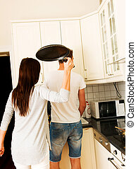 Aggressive woman with pan.
