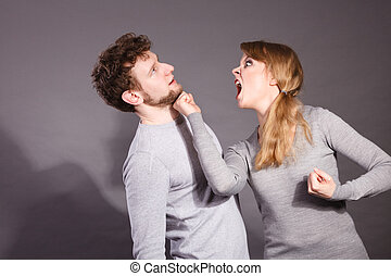 Aggressive woman yelling on man.